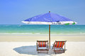 Umbrella and chairs at beach over blue sky in the summer holiday concept Royalty Free Stock Photo