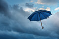 Umbrella and cloudy sky closeup Royalty Free Stock Image