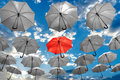 Umbrella standing out from the crowd unique concept mental health depression Royalty Free Stock Photo