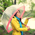 Umbrella woman in autumn excited under rain on fall day beautiful young female wearing raincoat surprised and the Stock Photos