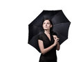 Umbrella young woman stands under a and smiles Royalty Free Stock Images