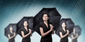 Umbrella young woman stands under a and smiles Royalty Free Stock Photos