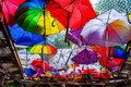 Umbrellas as roof of restaurant terrace Stock Images