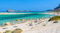 Umbrellas on Balos beach on Crete island, Greece Royalty Free Stock Photo