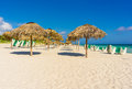 Umbrellas and beach beds on a beach in cuba the of varadero Royalty Free Stock Image