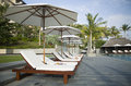 Umbrellas and loungers by the pool swimming Stock Photography