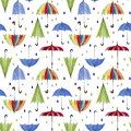 Umbrellas and rain drops on white background