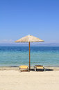 Umbrellas and recliners by the sea on exotic resort thassos island greece Royalty Free Stock Photos