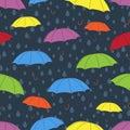 Umbrellas seamless pattern, vector background. Multicolored bright umbrellas and raindrops on a dark blue background