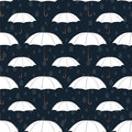 Umbrellas seamless pattern, vector background. White umbrellas and raindrops on a dark blue background. For wallpaper design, wrap