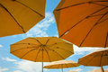 Umbrellas sunlight brown yellow and orange with the blue sky caffeteria hotel terrace balcony outdoor restaurant or garden Royalty Free Stock Photography