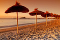 Umbrellas by the sunset Royalty Free Stock Image