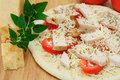 Un-cooked Chicken And Asiago Cheese Pizza Royalty Free Stock Photo