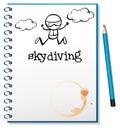Un cuaderno con una imagen de saltar en caída libre de la persona Imágenes de archivo libres de regalías