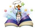 Un livre ouvert avec une image d une équitation de cowboy sur un cheval Photographie stock