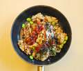 Unagi served on frying pan with egg rice and seaweed Stock Photo