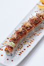 Unagi Sushi : Japanese Rice Wraped Avocado and Cheese Topping with Grilled Unagi Japanese Freshwater Eel and Katsuobushi Royalty Free Stock Photo
