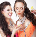 Unbalanced Diet Concept. Women Gourmets with Delicious Cupcakes.   Royalty Free Stock Photography