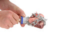 Unchain my heart wrapped in chain with a padlock being unlocked by a mans hands and key Royalty Free Stock Photo