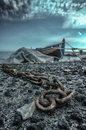 Unchained sea ​​landscape with a boat in the background and a chain in the foreground Royalty Free Stock Photo
