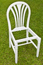 Uncomplete White Chair on Green Grass Stock Photography