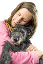 Unconditional friendship young woman cuddling with her dog concept of Stock Photos