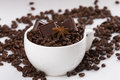 Unconventional capuccino cup filled with coffee beans sweet chocolates and aniy star Stock Images