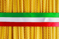 Uncooked Authenric Tripoline spaghetti pasta with italian flag style ribbons Royalty Free Stock Photo