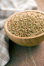 Uncooked buckwheat in wooden bowl Royalty Free Stock Images