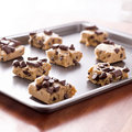 Uncooked cookie dough on a baking pan Royalty Free Stock Photos