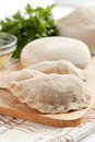 Uncooked dumplings made of flour, meal Stock Photo
