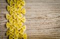Uncooked farfalle pasta background on the table Royalty Free Stock Images