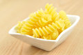 Uncooked fusilli in a small bowl, italian pasta Royalty Free Stock Photos