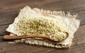 Uncooked hemp seeds with a spoon pile of close up Royalty Free Stock Photo
