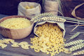 Uncooked Italian pasta Farfalle, Elbow macaroni and Fusilli Royalty Free Stock Photo