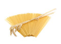 Uncooked long pasta and bunch of wheat spikes Royalty Free Stock Photo