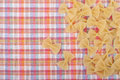 Uncooked pasta on the kitchen tablecloth Royalty Free Stock Photography