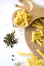 Uncooked pasta and spices Royalty Free Stock Image