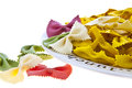 Uncooked rainbow farfalle pasta on plate Royalty Free Stock Photo