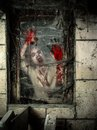 Undead at the window photo of a hungry zombie covered with blood Royalty Free Stock Images