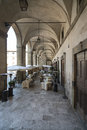 Under the arcades of the palace of the lodges arezzo tuscany italy europe vertical view inside Stock Photos