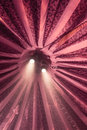 Under the big top vertical of inside of a circus tent with two spotlights and trapeze ladder and ropes Royalty Free Stock Photos