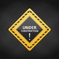 Under conctruction sign on dark metal background Royalty Free Stock Image