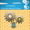 Under construction abstract colorful background with brick wall gears and the text written above the wall Royalty Free Stock Photos