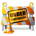 Under construction barrier warning sign and traffic cone Royalty Free Stock Photography