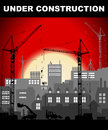 Under construction concept in industrial European vintage styled city under construction on bright red sunset Royalty Free Stock Photo