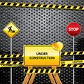 Under construction grunge background with warning symbols Stock Photos