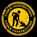 Under construction grunge yellow rubber stamp sign logo on white background Royalty Free Stock Image