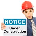 Under construction a man holding a safety sign indicating on going repair or Royalty Free Stock Image