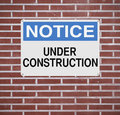 Under construction a notice sign indicating Royalty Free Stock Photos